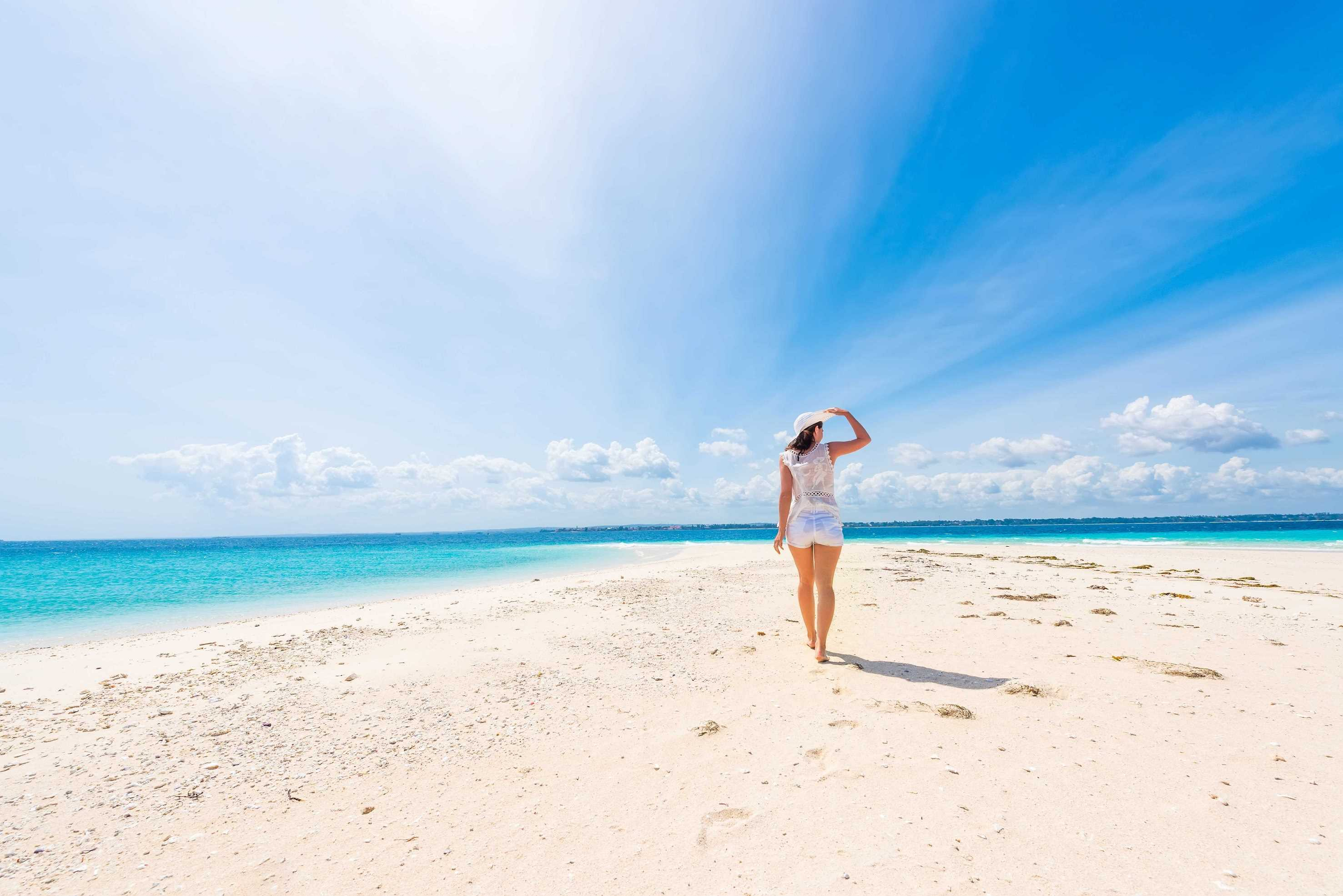 Lady on a White Sand Beach