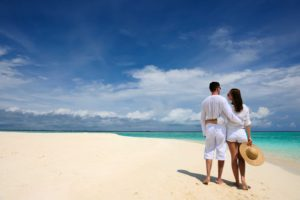 Couple in white on beach